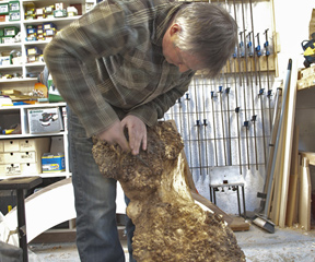 Phillip Hawkins at work carving a furniture piece